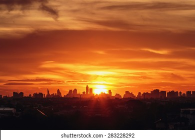 Sunset at city of Bangkok with  building silhouette