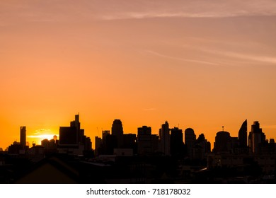 Sunset with city building