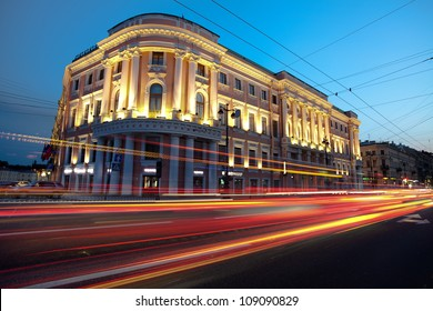Sunset in the city. Lights cars. (Downtown St. Petersburg, Russian Federation)