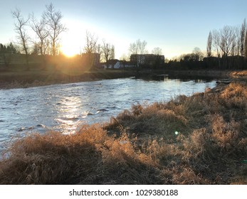 Sunset in city at river