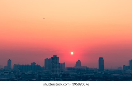 Sunset city scenery with sun and building in Bangkok; Thailand