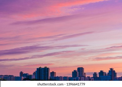 Sunset in the city, sky with clouds, background