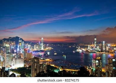 sunset of city, Victoria Harbor in Hong Kong