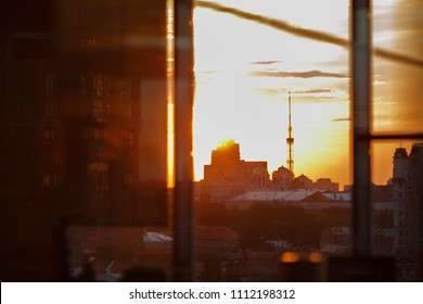 Sunset in the city. View from the high floor, the last lights before the night.