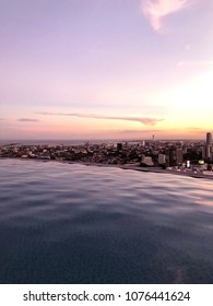 Sunset City View from Rooftop Infinity Pool