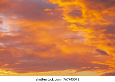 Sunset cityscape. Silhouette buildings against an orange sky. City view at sunset. Bright orange sky at sunrise. Dramatic sky with purple clouds. Golden sky. Sundowners in the city