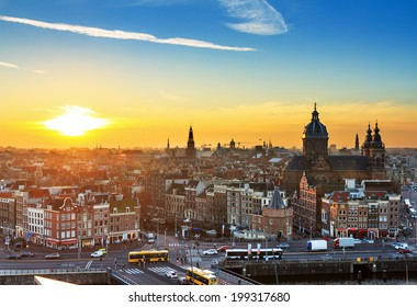 Sunset cityscape in winter of the skyline of Amsterdam, the Netherlands.