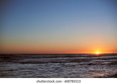 Sunset clean sky in ocean sea scape. Panorama seascape in sunset light