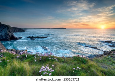 Sunset from the clifftop at Longcarrow Cove near Padstow on the north coast of Cornwall