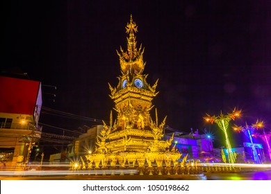 sunset at clock tower in Chiang Rai town. beautiful sculpture clock tower in central of Chiang Rai city.the color of clock tower start to change in twilight