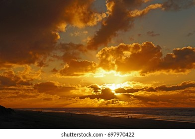 Sunset with clouds at the beach