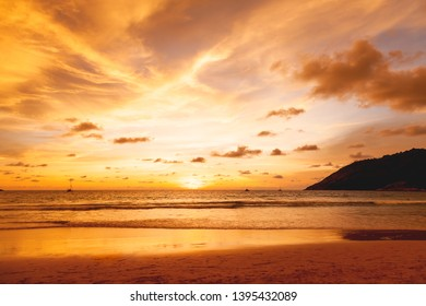 Sunset with clouds of different shapes. Gorgeous sunset at Nai Harn beach. Phuket island, Thailand, Indian ocean.