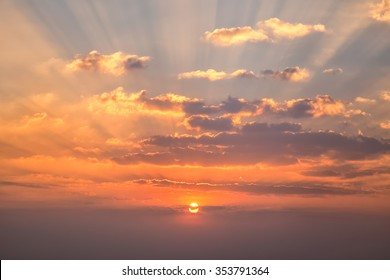Sunset with clouds, light rays and other atmospheric effect