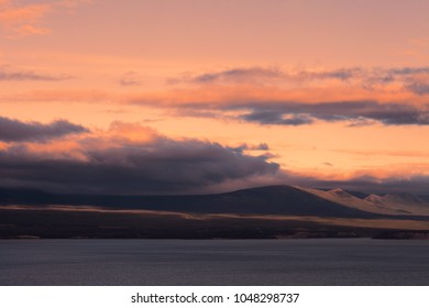 Sunset with clouds near Kuane Lake in the Yukon Territory, Canada in summer.