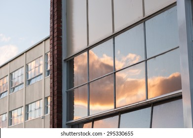 Sunset clouds reflected in a generic window