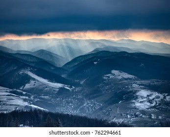 Sunset in cloudy weather in Beskids Mountains in winter. Near Rytro Village, view from Mount Makowica.