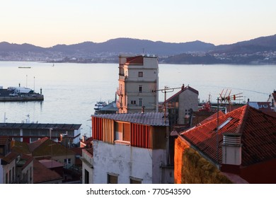 sunset in the coast of Vigo city with old buildings