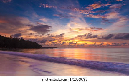sunset with colorful reflections and sky on beach in Khao Lak Island in Thailand