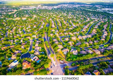 Sunset colors over Modern homes and houses in suburb. High aerial view above thousands of homes north of Austin , Texas in Round Rock Suburbia sunset colors of new development neighborhood