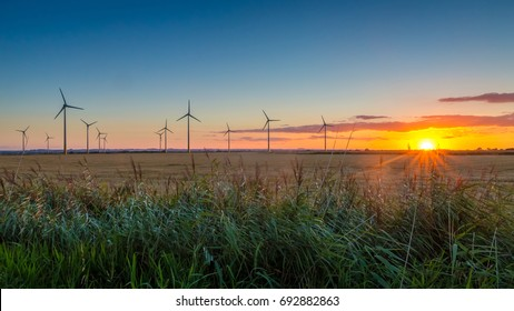 Sunset at Conisholme Wind Farm in Lincolnshire