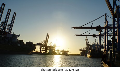 sunset at container terminal in the harbor of hamburg