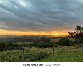 Sunset in Country setting with rolling hills, fences and trees