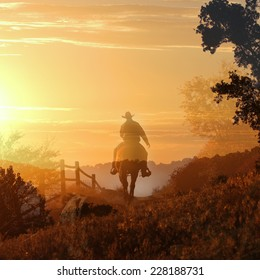Sunset cowboy riding a horse over the mountains into the sunset.