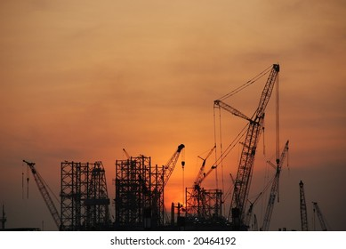 sunset, crane at the seaside