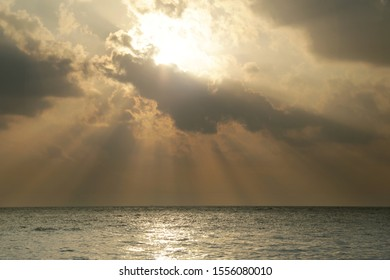 Sunset with Crepuscular Ray On The Sea