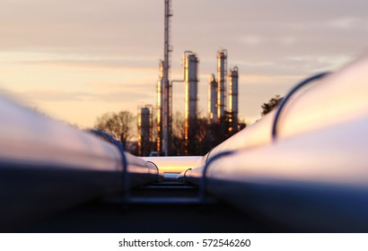 sunset at crude oil refinery with pipeline network
