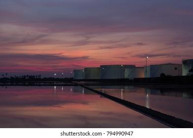 Sunset, crude oil tanks