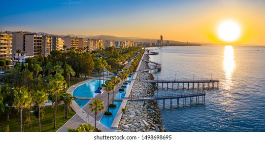 Sunset in Cyprus. The sun sets in the Mediterranean. Limassol at sunset. Evening panorama of Limassol with height. Mediterranean evening landscape. Holidays in Cyprus.