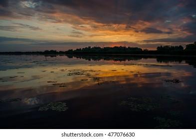 Sunset in Danube Delta, Romania. Beautiful blueish lights in water