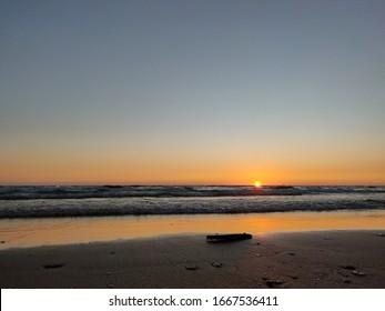 Sunset in the dark sea.