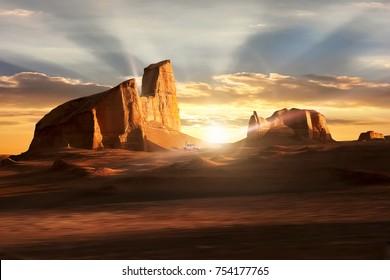 Sunset in the Dasht-e Lut Desert. Beautiful rays under the rocks. Iran. Kerman.