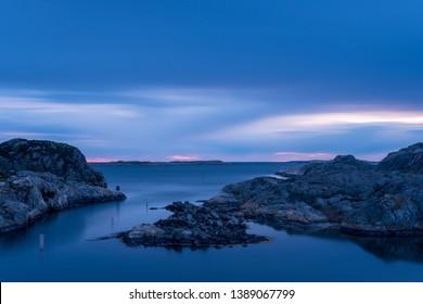 Sunset with a deep blue sky outside Grundsund in archipelago on the Swedish west coast in Bohuslän.