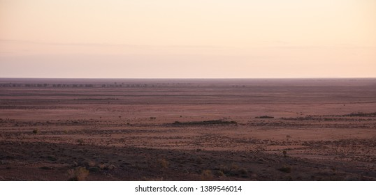 Sunset in the desert, the Australian Outback. Crossing the Simpsons dessert, one of the driest places on earth but full of wildlife and culture.