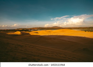 Sunset in the desert with beautiful sand dunes.