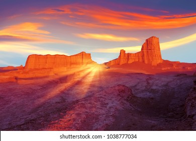 Sunset in the desert of Iran. Alien planet concept. Ultraviolet, blue, orange, red and yellow artistic image.