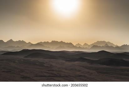 Sunset in desert mountains