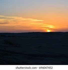 Sunset in the desert of Sahara. North Africa