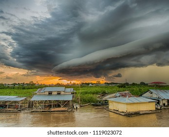 Sunset and dramatic clouds  before the storm on the sky over the Amazon river, Amazonia, Santa Rosa, Peru.