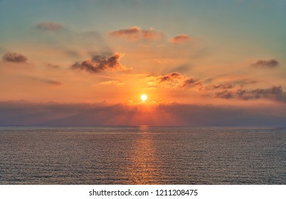 sunset with dramatic cloudscape over the sea