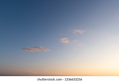 Sunset dramatic orange clouds blue sky background