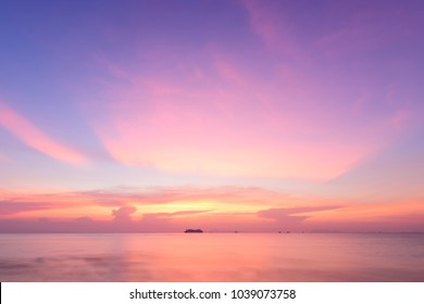 Sunset dramatic pastel sea sky and cloud background,Long exposure shot
