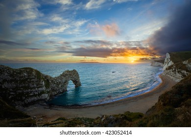 Sunset at Durdle Door on the Jurassic Heritage south coast of Dorset in England.