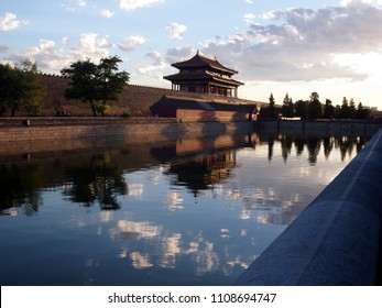 Sunset (early evening)'s reflections of the North side of the Forbidden city - iconic location in Beijing, China.