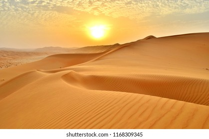 Sunset at the Edge of the Rolling Sand Dunes in the Empty Quarter (Desert) outside Abu Dhabi, United Arab Emirates