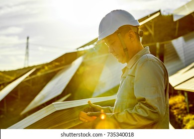 Sunset engineers are checking solar panels