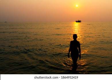 Sunset evening and silhouette on beach at Koh Chang Thailand.